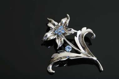 brooch with silver flowers and jewellry
