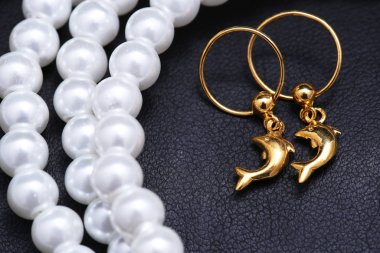 Pair of earrings,Gold dolphin