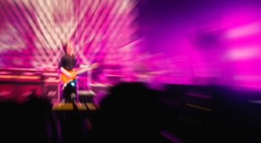colorful defocused blurred concert people crowd background.