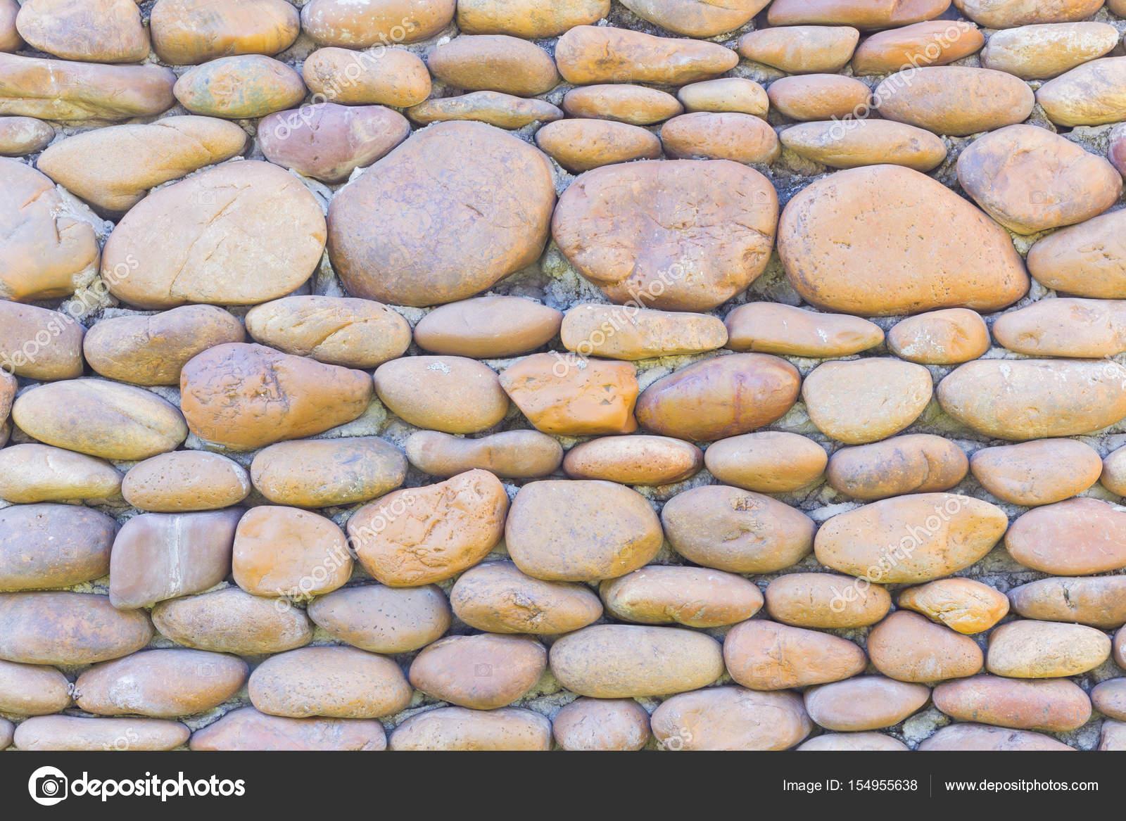 galets de rivi re ronde fond de mur en pierre photographie a3701027d 154955638. Black Bedroom Furniture Sets. Home Design Ideas