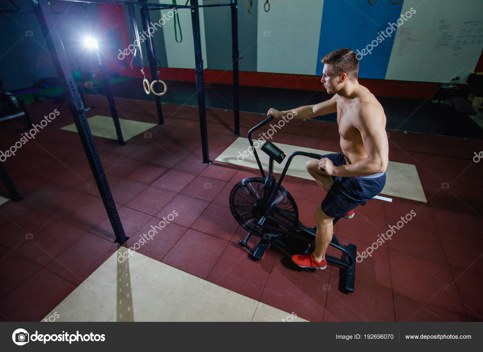 Fit Young Man Using Exercise Bike At The Gym Fitness Male Air For Cardio Workout Cross Training Photo By Satyrenko
