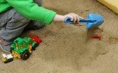 Kids play in the sandbox.