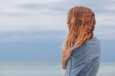 Woman alone and depressed at seaside