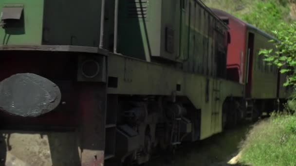 old train travels through Sri Lanka, crossing the jungle