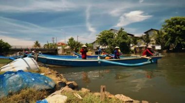 Fishing boats sailing in river in Cilacap, Java, Indonesia