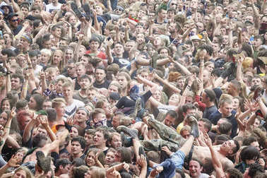People having fun at a concert during the 23rd Woodstock Festival Poland.