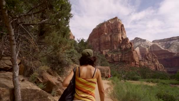 A young woman starting the trekking on the Angels Landing Trail in Zion National Park, Utah. United States