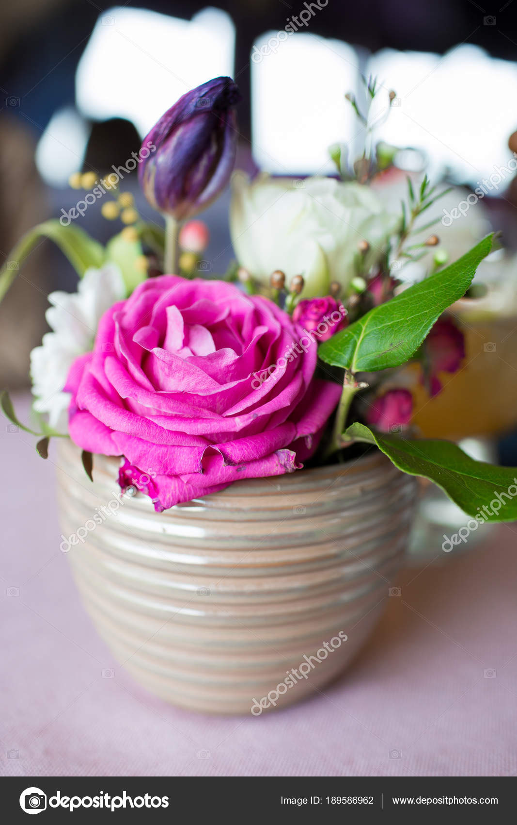 Pink Flowers In A Vase A Beautiful Bouquet In A Beige Vase On The