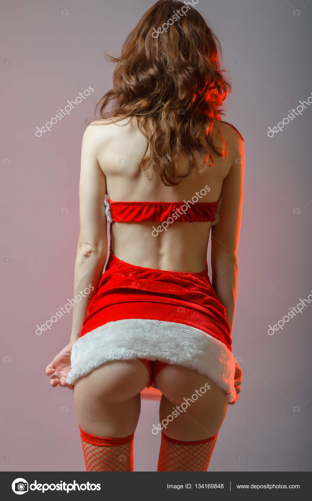 young and sexy santa girl with a big ass. — stock photo