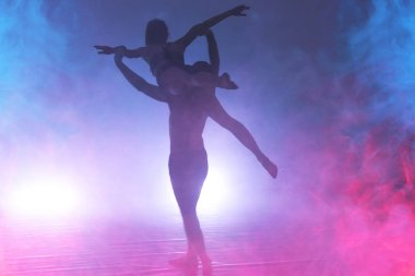 Young modern dancers dancing in the studio. Sport, dancing and urban culture concept. Group of young dancers performing on the stage. Effective performance. beautiful dance.