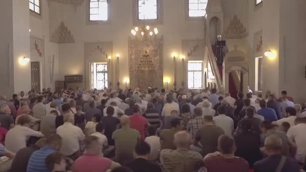 Religious muslim prayers praying together inside the big mosque.