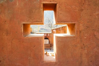 the cross in the wall