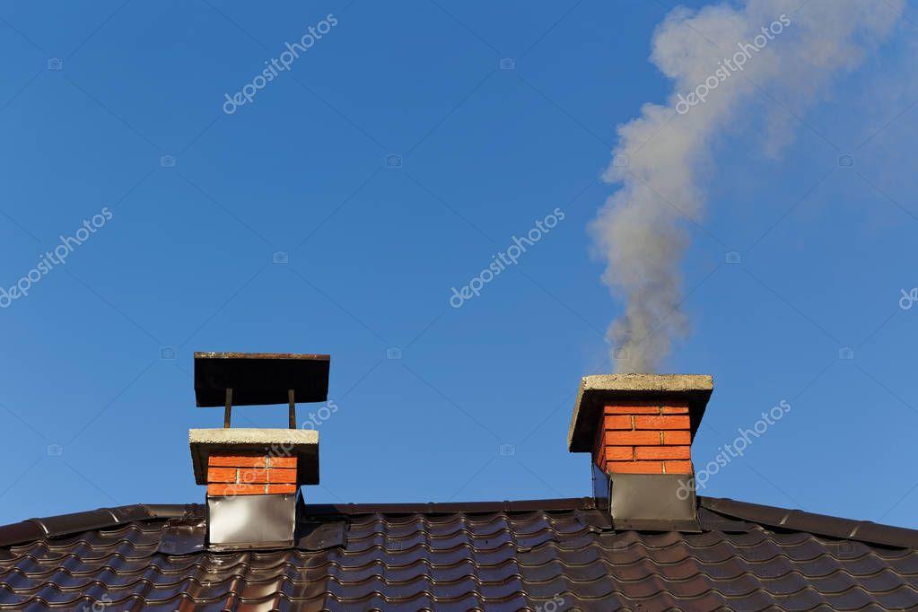 Smoke from brick chimney