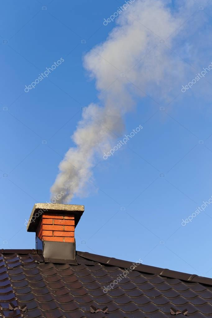 Smoke from brick chimney