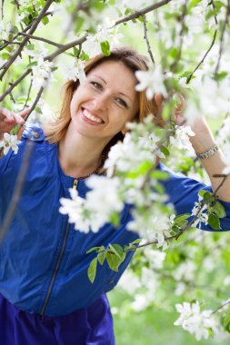 smiling woman is walking at  garden