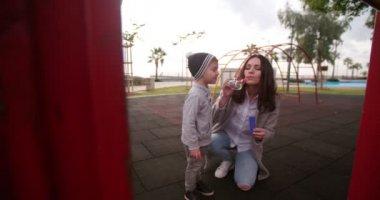 boy popping bubbles
