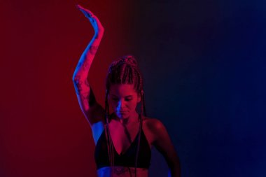 Black dressed and braided hair woman dancing on a blue and red b