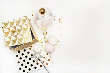 Party background mockup. Flat lay. Notebook polka gold with cakes and magic star, confetti. Header for site or Hero