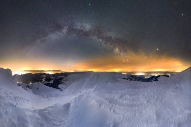 Starry night sky panorama, Milky way galaxy with stars and space dust in the universe, winter landscape in mountains.