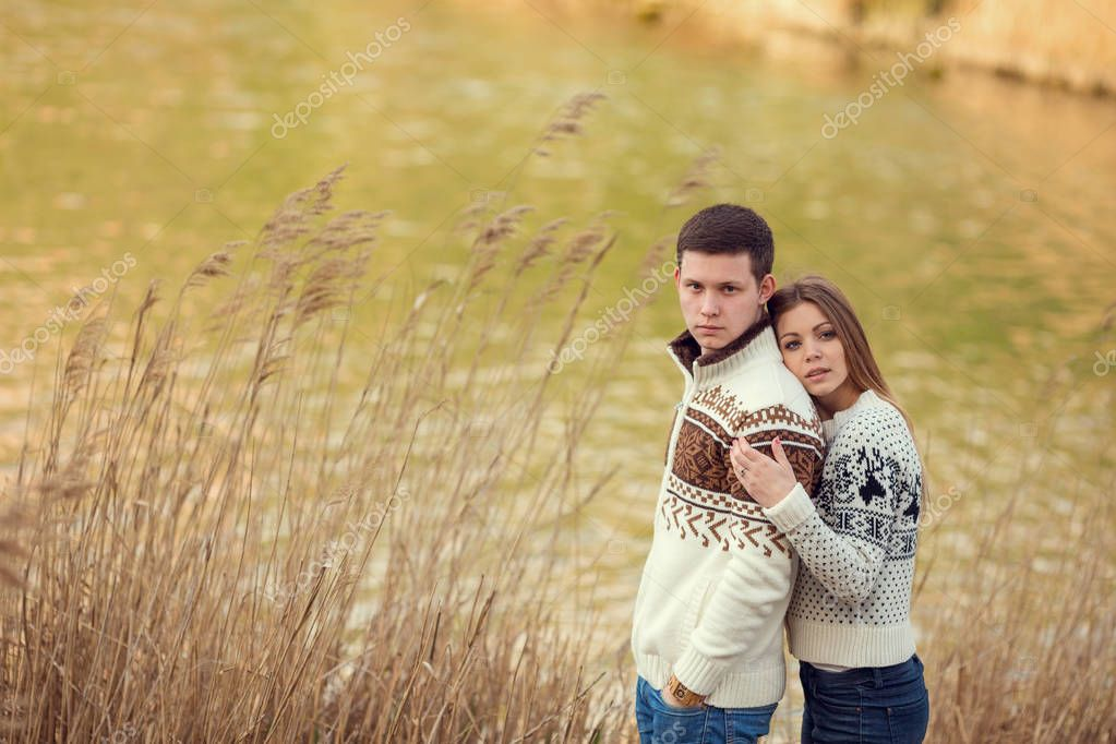 couple hugging near lake