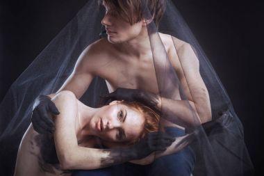 couple lying under veil