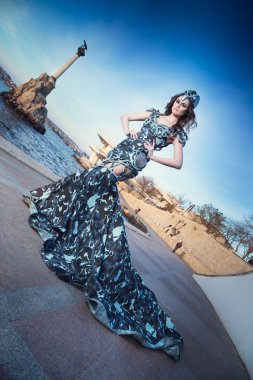 Full length portrait of beautiful dark-haired fantasy girl in gray dress stock vector