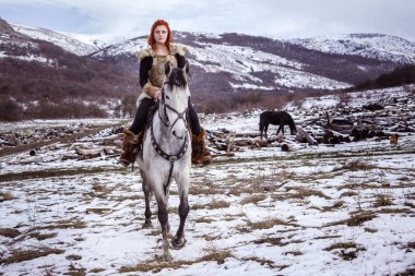 Viking woman with gray horse
