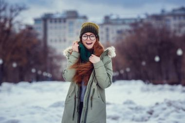 girl in coat and hat with scarf