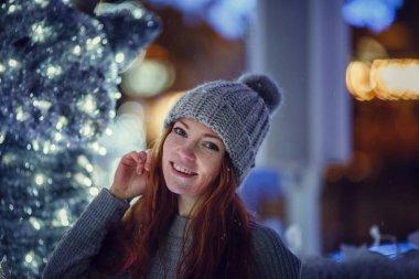 redhair girl in warm hat