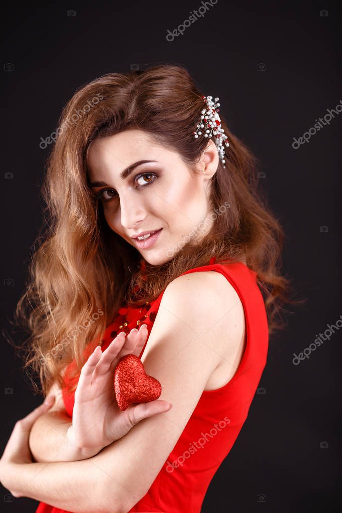 woman holding red heart