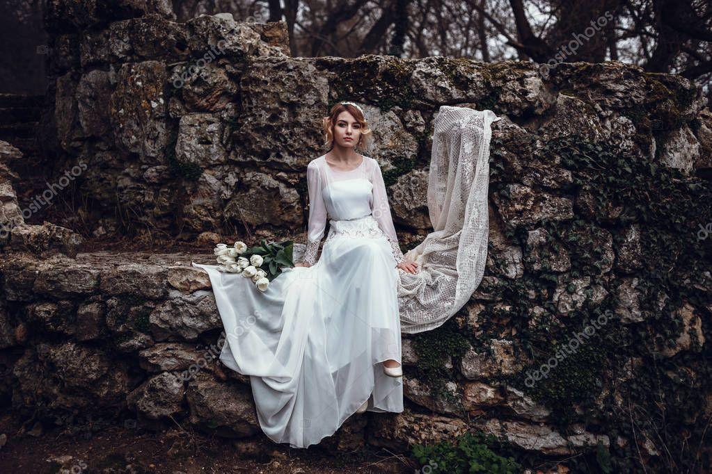 blonde woman in long white dress