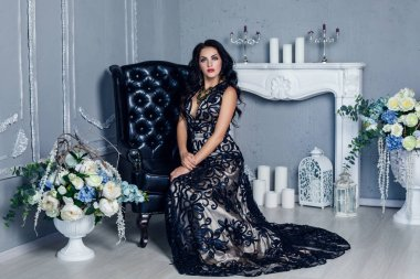 Elegant brunette sexy woman sitting on chair in fashionable dark dress, full length stock vector