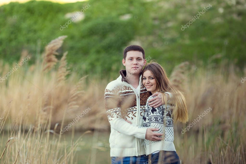 couple hugging near lake