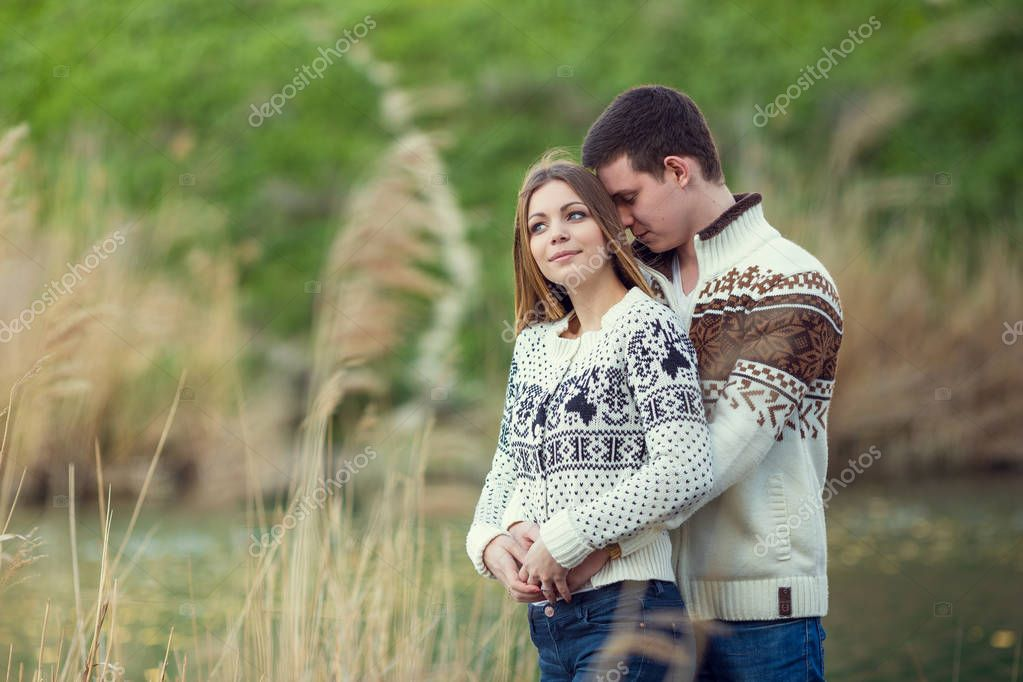 couple posing hugging