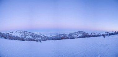 Winter landscape in Rodopi Mountains. Bulgaria, at sunrise. Panoramic view.