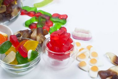 Tasty Different jelly candy on white background