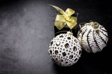 Elegant Christmas background with white retro balls and gifts