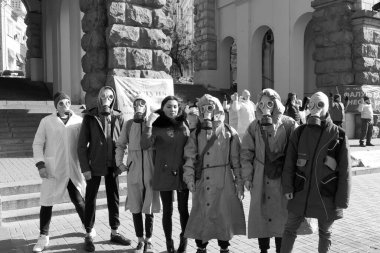 Kiev, Ukraine - March, 14, 2020: a group of people in protective suits who are afraid of a terrible disease.