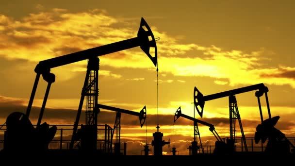oil pumpjacks against orange dusk