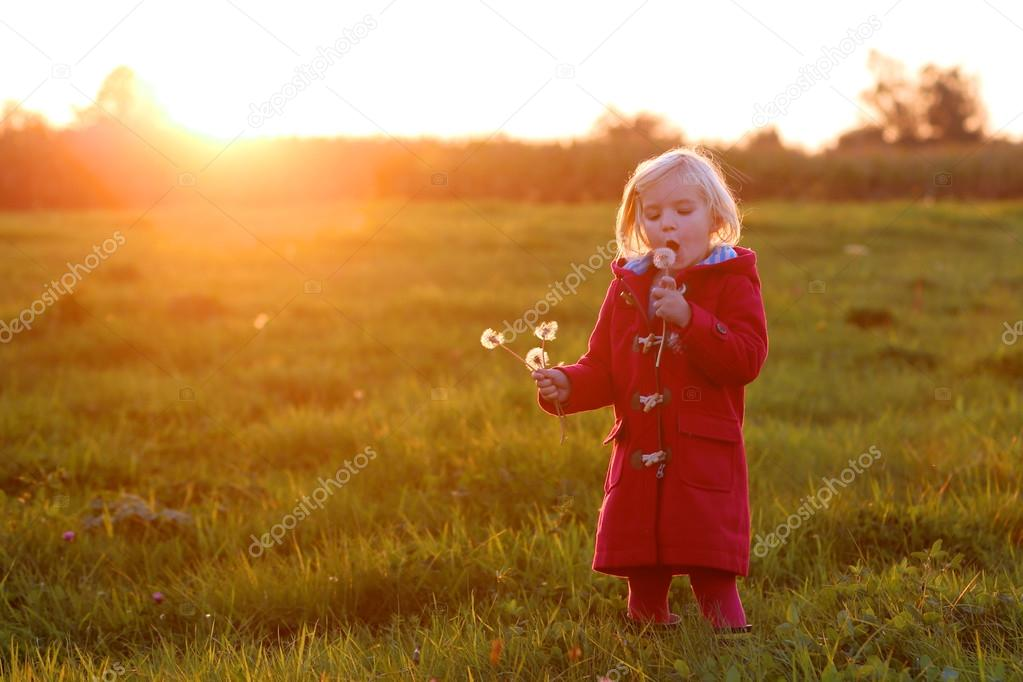 Little girl outdoors at sunset