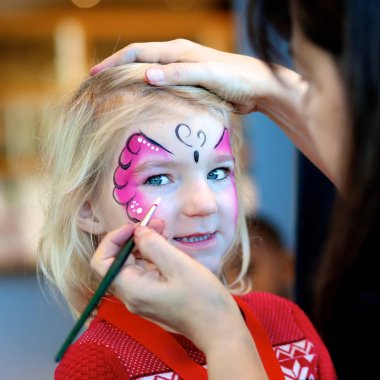 Artistic face painting for small children