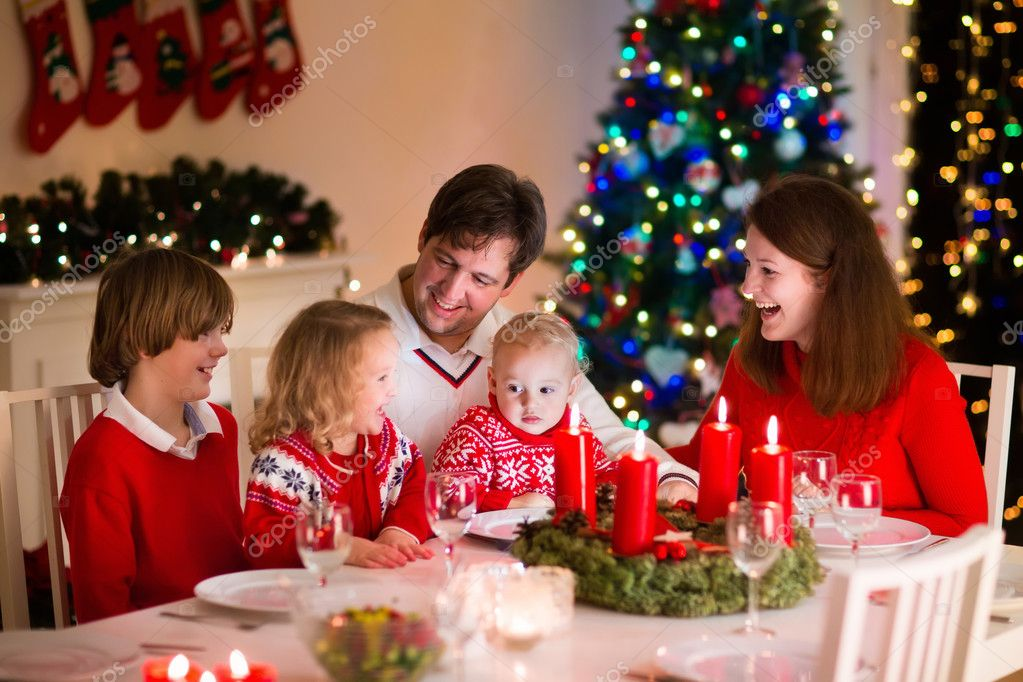 Family with children at Christmas dinner at home — Stock Photo ...