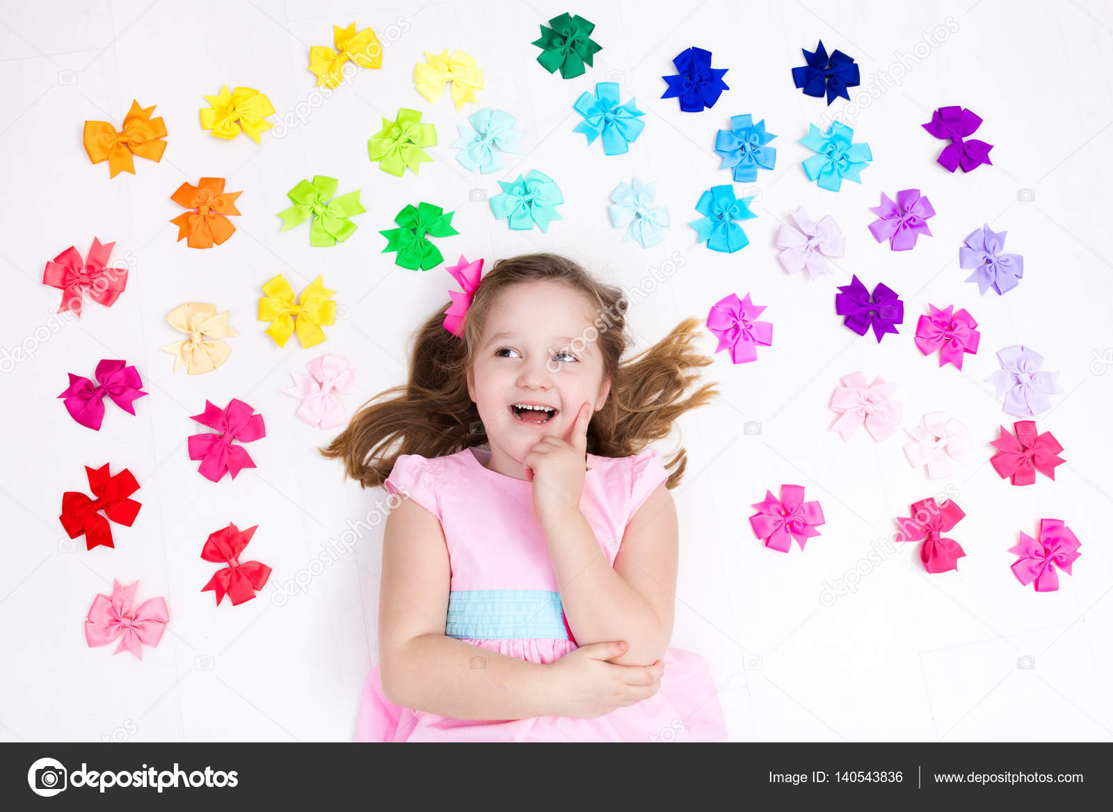 Little Girl With Colorful Bow Hair Accessory Stock Photo