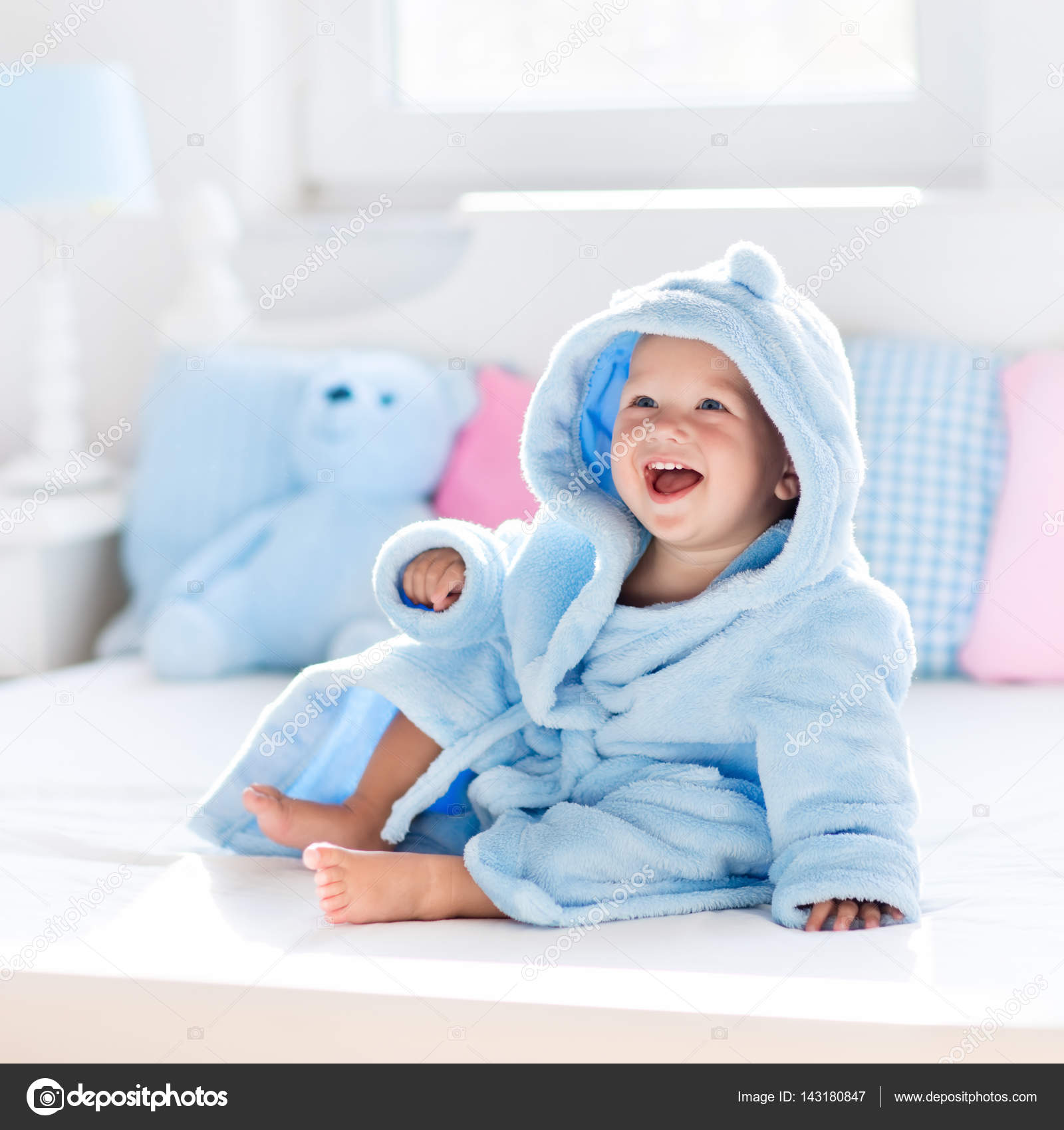 Baby in bathrobe or towel after bath — Stock Photo © FamVeldman ...
