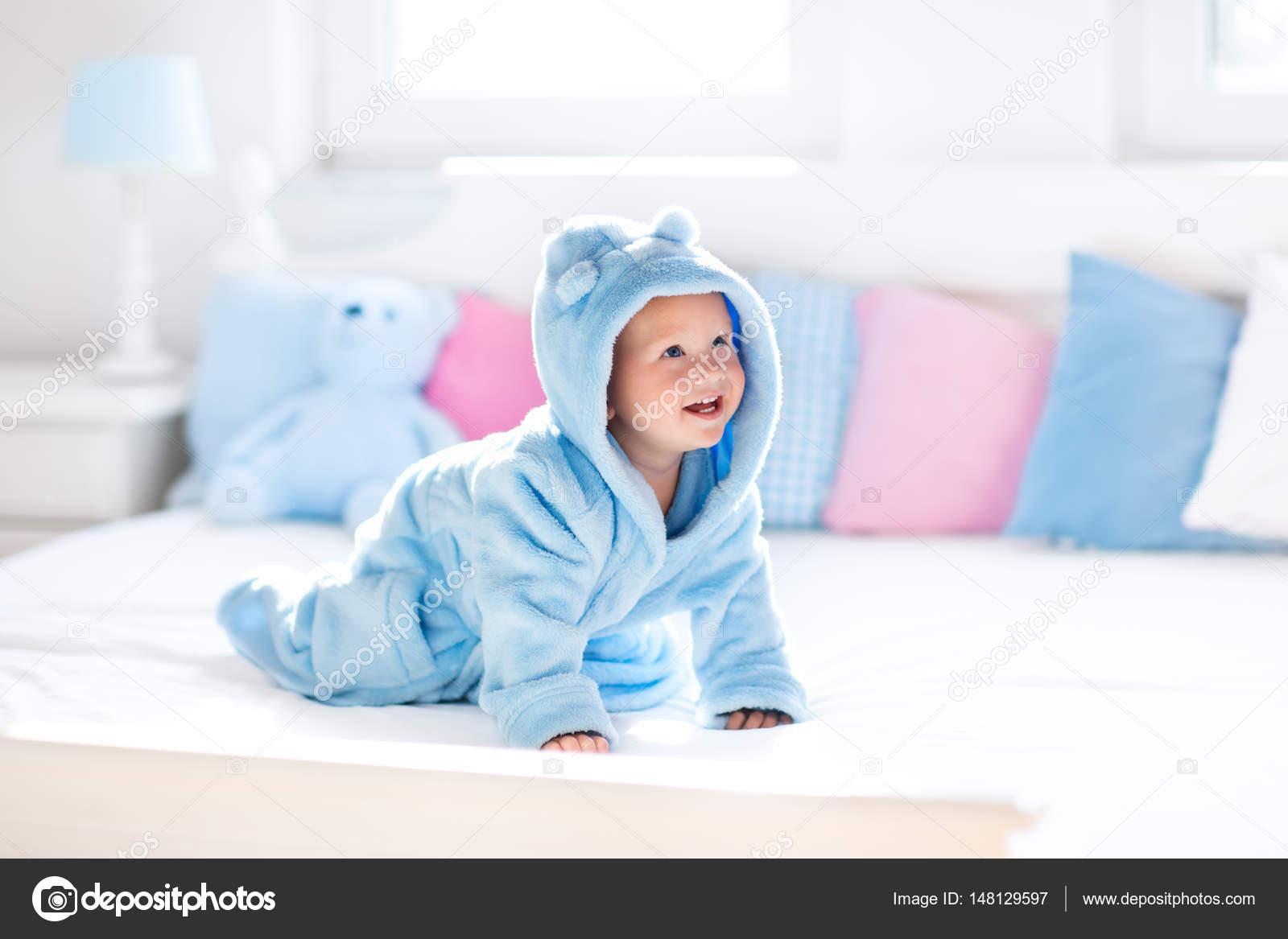 Baby in bathrobe or towel after bath — Stock Photo © FamVeldman ...