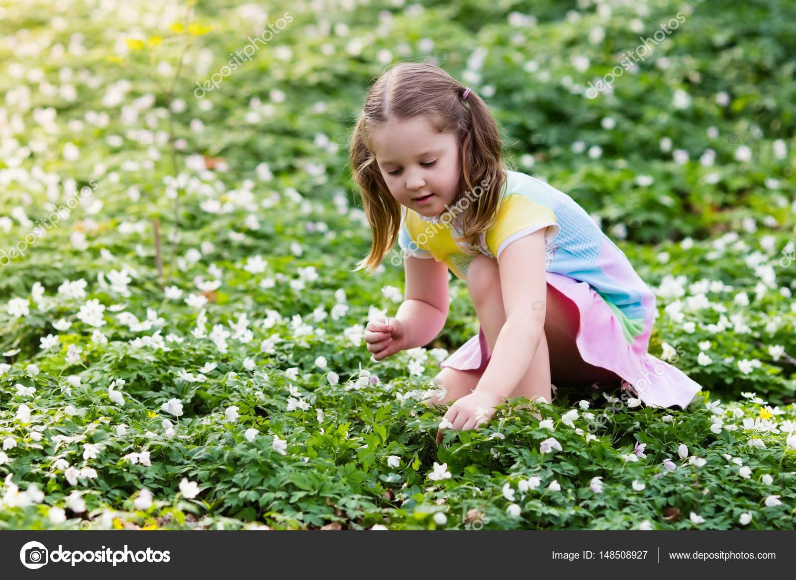 Child In Spring Park With Flowers Stock Photo Famveldman 148508927