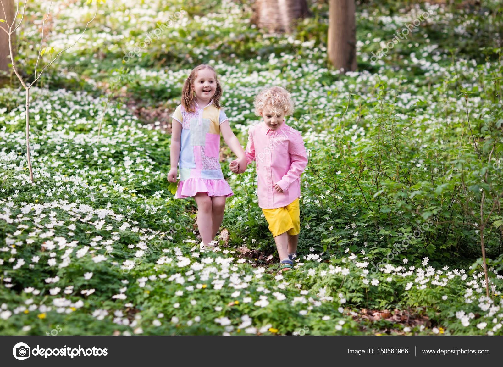 Children In Spring Park With Flowers Stock Photo Famveldman