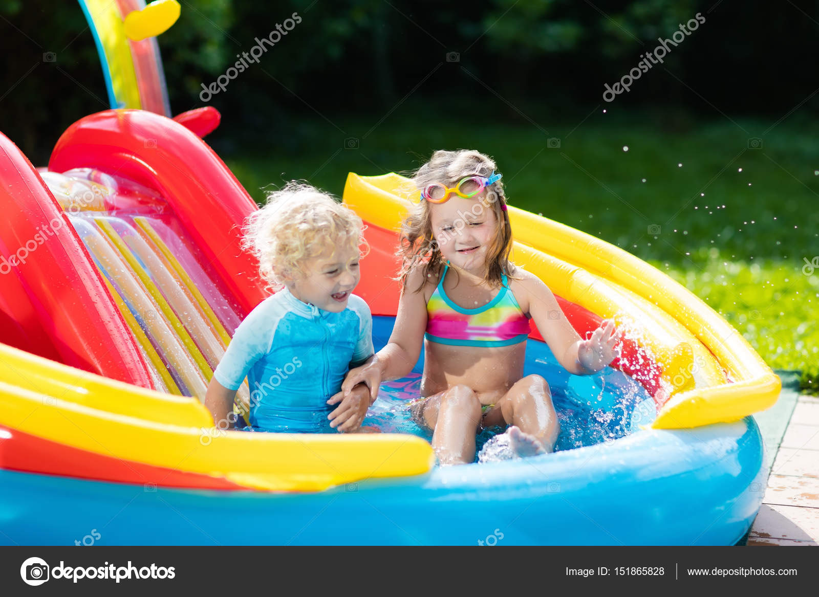 Children Playing In Inflatable Baby Pool With Slide Kids Swim And Splash Colorful Garden Play Center Happy Boy Girl Water Toys On Hot