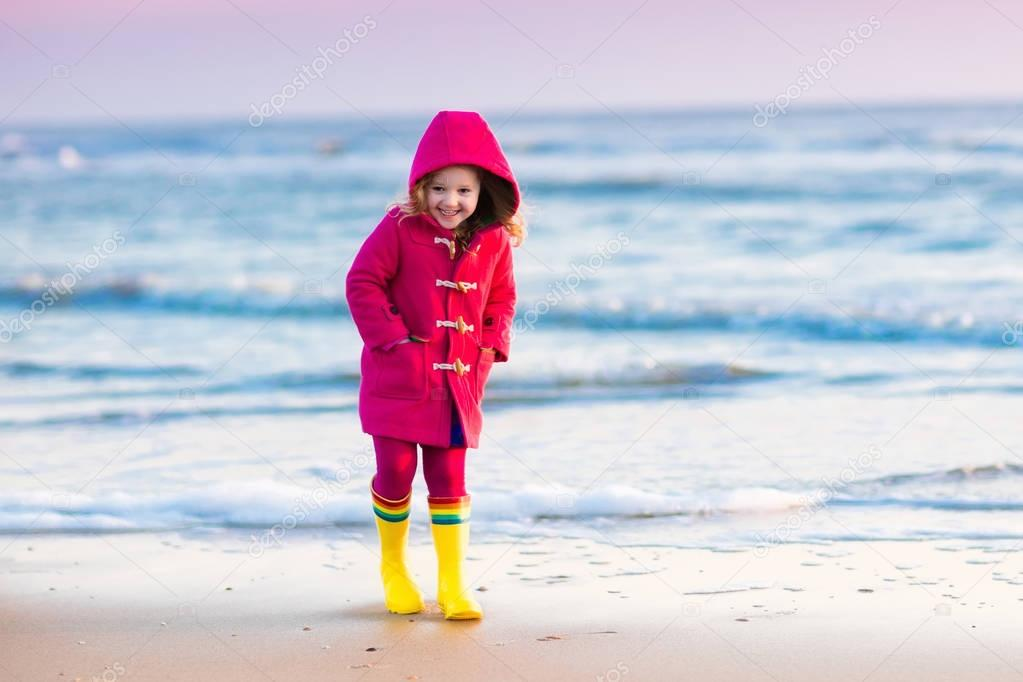 Child on North Sea beach in winter