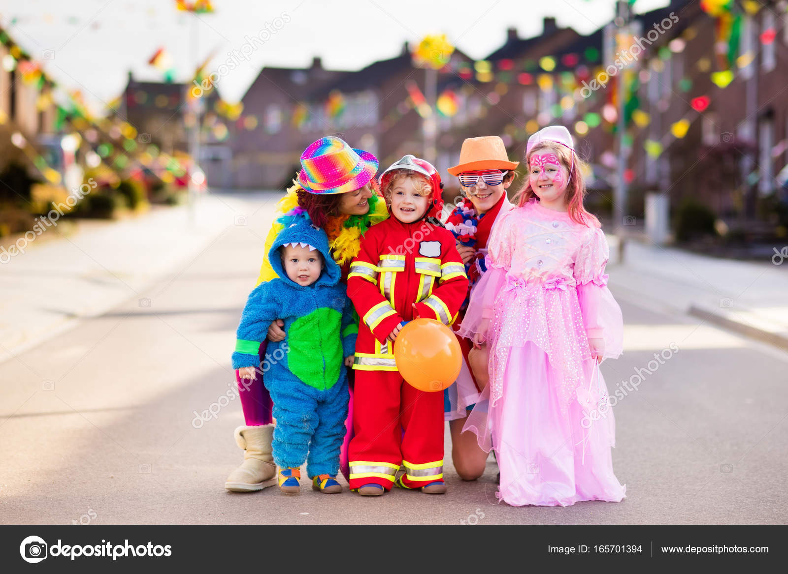 kids and parents on halloween trick or treat — stock photo
